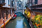 Gondola and restaurant, canal, Venice, Venetia, Italy, Europe