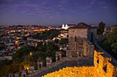 Castelo de San Jorge, St. George's Castle in Alfama district at dusk with Igreja da Graca church in distance, Lisbon, Lisboa, Portugal