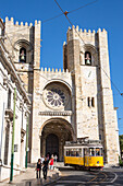 Electrico 28 tram passing in front of Se Catedral cathedral in Alfama district, Lisbon, Lisboa, Portugal