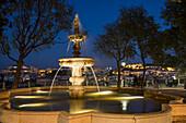 Fountain in the park at Miradouro Sao Pedro de Alcantara in Chiado district at dusk, Lisbon, Lisboa, Portugal