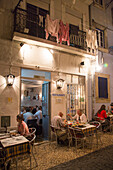 People sitting outdoors and enjoying dinner at Adega do Ribatejo in Bairro Alto district, Lisbon, Lisboa, Portugal