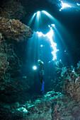 Scuba Diver inside Cave, Zabargad, Red Sea, Egypt