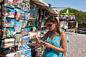 Young woman buying postcards, Burano, Venice, Venezia, Italy, Europe