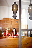 Two receptionists at the front desk of Hotel Market, Comte Borrell 68, Barcelona, Spain