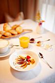 Breakfast with muesli, cereals and orange juice,  S. Cassiano, Alta Badia, Italy
