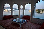 On the left the Lake Palace Hotel, Lake Pichola  Udaipur  Rajasthan  India.