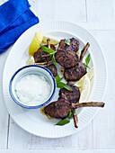 Plate of lamb mint and yogurt. Barbequed Lamb Cutlets _ Mint, Lemon, Yoghurt