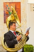 A tuba player of the Minori Concert Band entertaining in the village square in Ravello, Italy