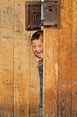 China, Gansu, Amdo, Xiahe, Monastery of Labrang Labuleng Si, Cheerful Tibetan boy
