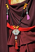China, Gansu, Amdo, Xiahe, Monastery of Labrang Labuleng Si, Losar New Year festival, Monk´s traditional dress and jewellery
