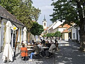 Szentendre near Budapest  Coffee shops in the town center with tourists  Szentendre, which calls itself the town of artists and churches, is located on the banks of river Danube close to Budapest and is one of the major attractions in Hungary  The little.