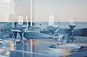 Reflected sea on a restaurant´s window  Denia  Alicante  Spain