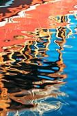 Boats reflecting in the water, Antalya harbor, Turkey