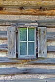 Rustic Window of a Log Cabin with Handmade Wood Shutters