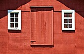 Rustic Red Barn Door with Two White Wood Windows