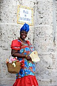 Afrocuban lady with flowers and traditional costume in La Havana ,Cuba