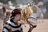 "A Cora Indian man, wearing a demon mask, takes a part in the religious ritual ceremony of Semana Santa Holy Week in Jesús María, Nayarit, Mexico, 21 April 2011  The annual week-long Easter festivity called ""La Judea"", performed in the rugged mountain coun"
