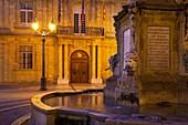 Fountain and front facade of Hotel de Ville at Place de l´Hotel de Ville, Aix-en-Provence, France