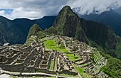 Machu Picchu famous Inca ruins on mountain looking down in Peru historical Wonder of the World