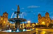 Beautiful colorful night exposure of fountain Main Square in center of Cusco Cuzco Peru in South America