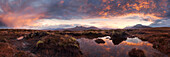Vast panorama of the North West Highlands with a view to the summits of the An Teallach mountains during a spectacular sunrise, Torridon, Ullapool, Scotland, United Kingdom