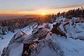 Cold Sunset with a wide view from Pramenac above the heavily snow covered Ore Mountains, Ustecky kraj, Czech Republic