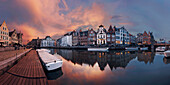A colorful sunset over the canals of the old city of Ghent in Flanders with the historic gabled houses of Graselei (left) and Korenlei (right), Belgium