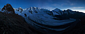 View above the imposing Pers Glacier in the blue light of the incipient night with first stars showing up over the summits of Piz Trovat (3146 m), Piz Cambrena (3602 m), Piz Palu (3901 m), Piz Zupo (3996 m) and Piz Bernina (4048 m) (from left), Engadin, S