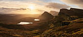Sunrise above the Trotternish peninsula with a wide view to the hills of Quiraing at the northern end of the Isle of Skye, Scotland, United Kingdom