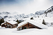 Alpine huts and mountain panorama at Gimmeln, Muerren, canton of Bern, Switzerland