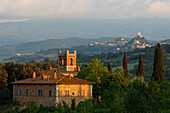 View to the village of Radicofani with tower, country house and cypresses, near San Quirico d´Orcia, Val d'Orcia, Orcia valley, UNESCO World Heritage Site,  province of Siena, Tuscany, Italy, Europe