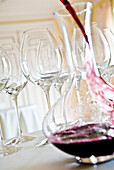 Red wine being poured into a decanter, Red wine glasses, Hamburg, Northern Germany, Germany