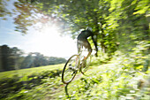 Man cyclocross touring in autumn, Oberambach, Munsing, Bavaria, Germany