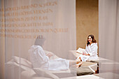 Two hotel guests in relaxation room, Tannheim, Tannheim Valley, Tyrol, Austria