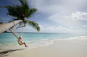 Girl in hammock at beach, Biyadhoo Island, South Male Atoll, Maldive Islands