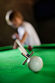 Boy playing billiard, Sri Lanka