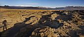 Shadow of a photographer, sandstone formations, Dyrholaos, Myrdalsjokull, South Iceland, Iceland
