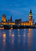 Water surface in front of the Westminster Bridge with Westminster Palace and Big Bend in the evening, London, England