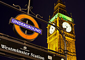 Sign of the Westiminster underground station with Big Ben in the background, London, England