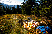 Hikers lying on autumnal alp, Planai, Schladming, Styria, Austria