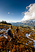 Couple hiking, Dachstein in background, Planai, Styria, Austria