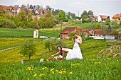 Two young women on a pasture with cattle, Styria, Austria