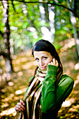 Young woman in autumn forest, Styria, Austria