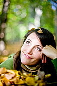 Young woman between autumn leaves, Styria, Austria