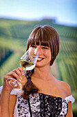 Young woman drinking a glass of white wine, Gamlitz, Styria, Austria