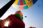Young woman in a hot-air balloon, Styria, Austria