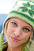 Young woman wearing a woolly hat looking at camera, Styria, Austria
