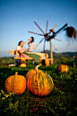 Two young women, pumpkins in foreground, Styria, Austria