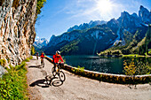 Mountain bikers at lake Gosausee, Salzkammergut, Upper Austria, Austria
