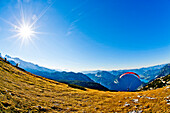 Paraglider on mount Krippenstein, Dachstein mountains, Upper Austria, Austria